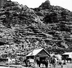 Man and Horses in front of Cabin in Echo Valley